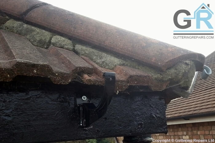 Roof repairs and gutter replacement on a semi detached house roof.