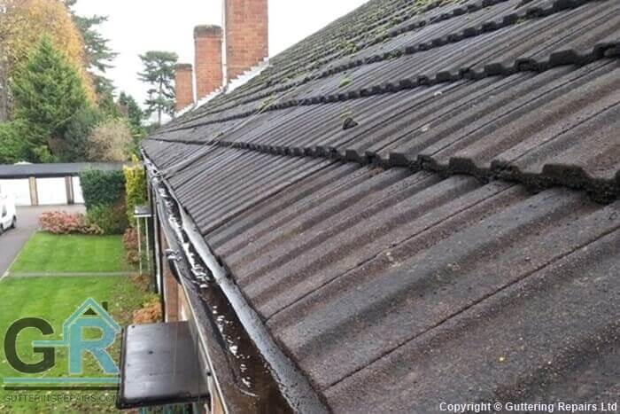 Roof gutter repair and cleaning on residential flats.